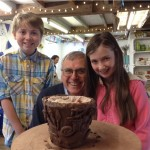 Grandad and Grandchildren making collaborative coil pot at Eastnor Pottery