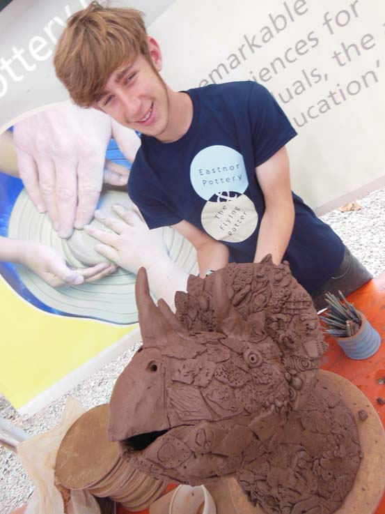 Elliot the potter with Eastnor Pottery producing clay dinos