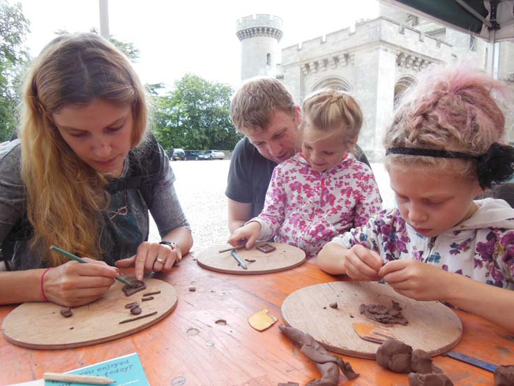 Families and Friends at Eastnor Castle making clay terracotta dinosaurs