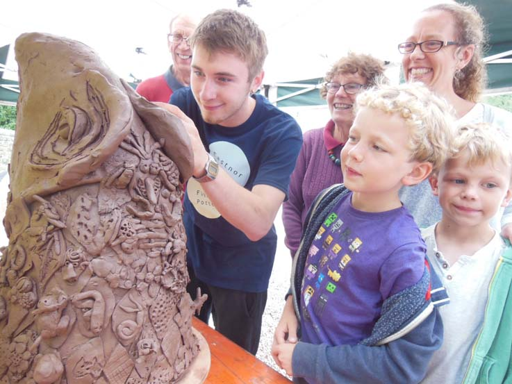 Jacob the Potter helping at Eastnor Castle making ceramic dinosaur heads