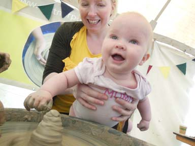 messy clay play fun on the potter's wheel for babies at Just So Festival 2016