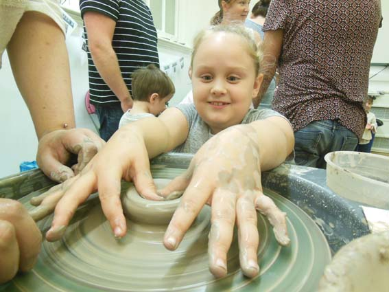 Eastnor Pottery teaching the art of throwing on a wheel at Wolverhampton