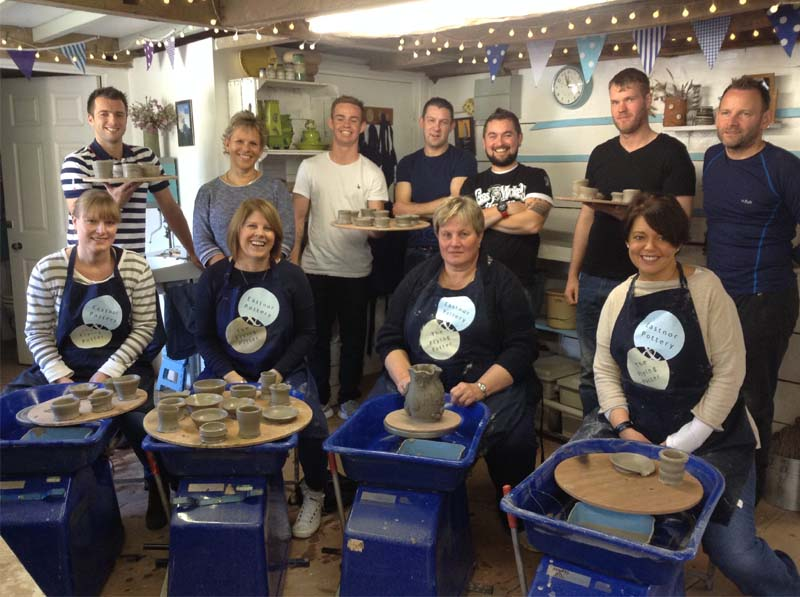Team Photo of Hereford Heating at Eastnor Pottery after teambuilding workshop