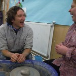 Jon Williams working on the potter's wheel with a student at Sunfield residential School