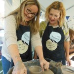 Learning to throw on the Potters Wheel at Eastnor Pottery for Clay themed Hen Parties