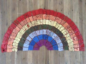 Rainbow tile panel created by students at St Marys Primary School Fownhope Herefordshire