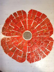 Poppy tile panel made by children at Devonshire Academy and Eastnor Pottery in the West Midlands