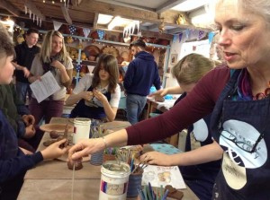 Students and staff from Alderman Knight School visit Eastnor Pottery to work on Cheshire Cat tile panel