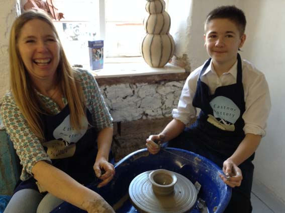 Sarah Williams works with student from Alderman Knight Special School at Eastnor Pottery