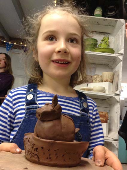 Children get to make a pot on the potterywheel at eastnor pottery