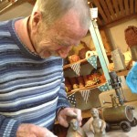 Guest artist Alan puts the finishing touches to his clay figures at Eastnor Pottery