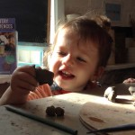 18 month old plays with clay at Eastnor Pottery