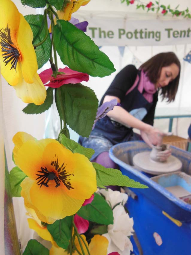 Hen making a pot on the potter's wheel at eastnor pottery and the flying potter