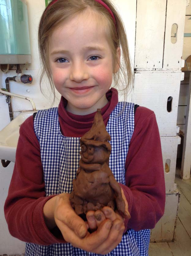 Pupil from Winterfold House School models a clay figure inspired by Julia Donaldson's illustrations