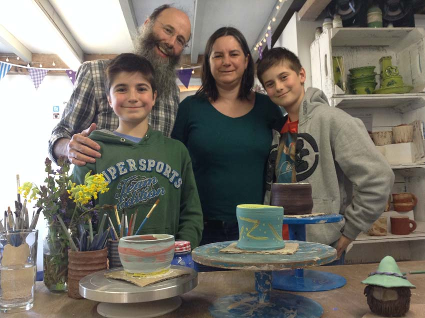 Family showing off their pottery skills at Eastnor Pottery