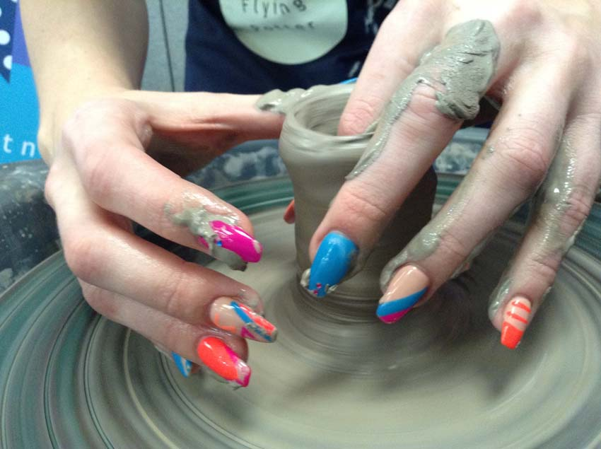 long painted nails on the potter's wheel at Expo 2017 photo competition runner up by Jon williems