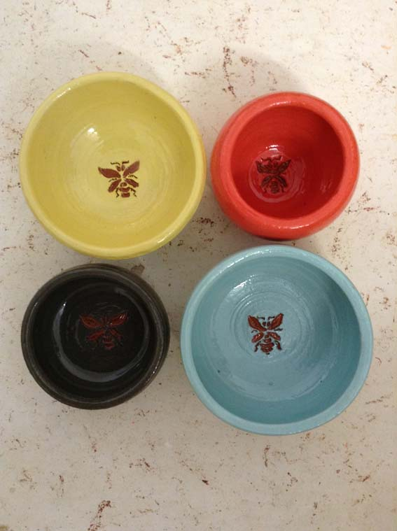 glazed bowls with sgraffito bee design
