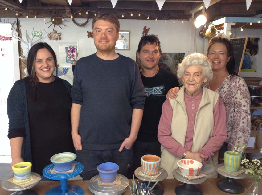 eve and her family display their pots they made to celebrates eve's 90th birthday at eastnor pottery
