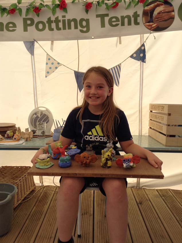 girl and her friends make clay models at her birthday party at eastnor pottery