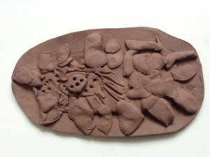 clay fish scale made by student at Regency High School in Worcester