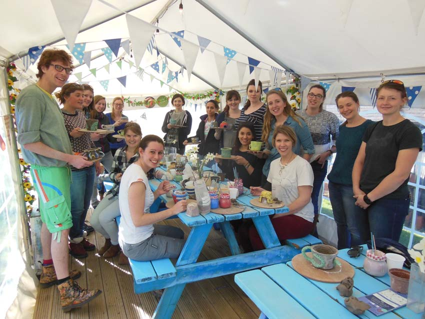 group of girls celebrate hen party by making pottery at eastnor pottery in herefordshire