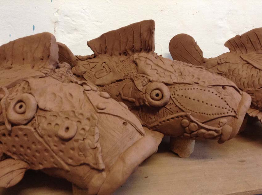 terracotta koi carp made by Regency High School and Eastnor Pottery