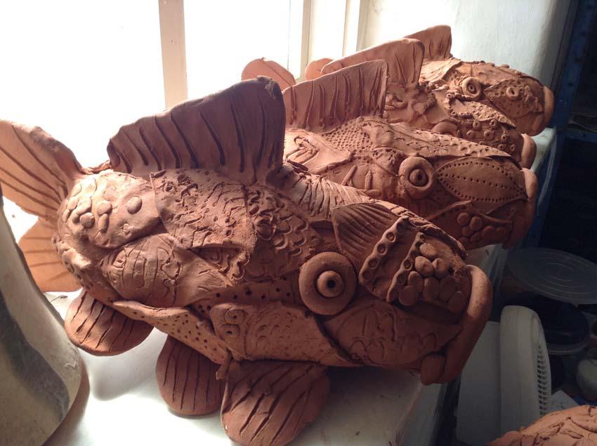 terracotta koi carp made by Regency High School Worcester SEN