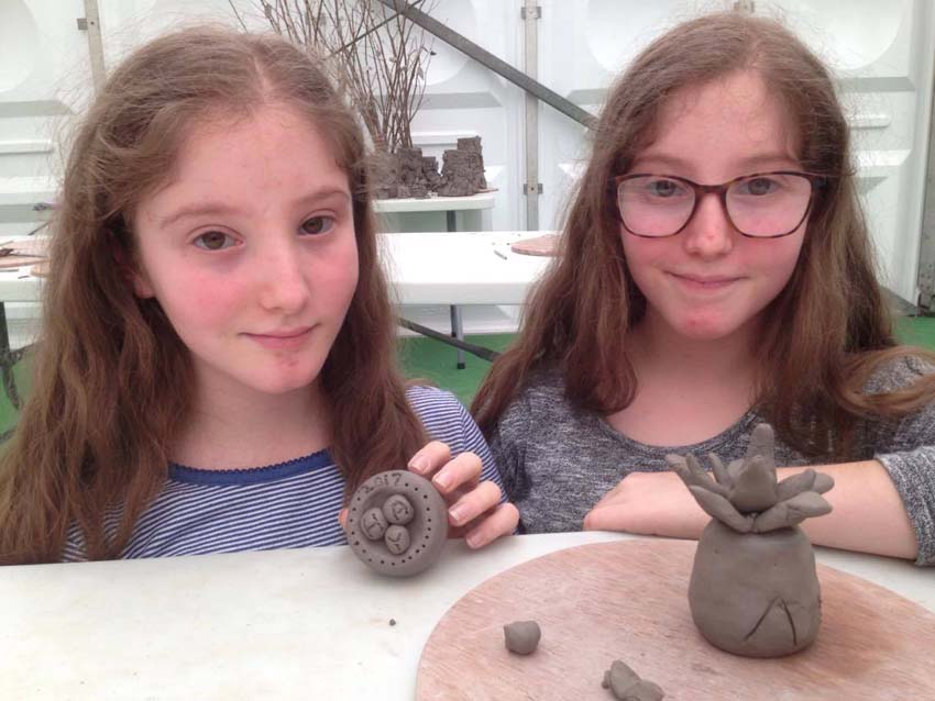 twin girls return to Hay on Wye Festival to make pottery with jon williams the flying potter