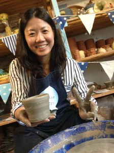 customer making a pot on the potter's wheel at Eastnor Pottery Summer 2017