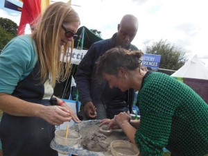 Adults try the pottery wheel at Lakefest 2017 Eastnor
