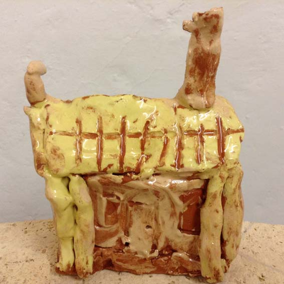 clay model of tudor house made by a child at Woodlands Infants School in Solihull
