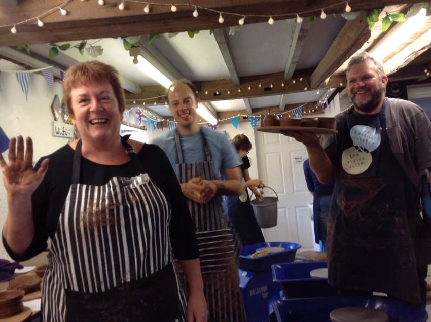 Pottery participants enjoy the social aspects of throwing pots together at Eastnor Pottery Herefordshire