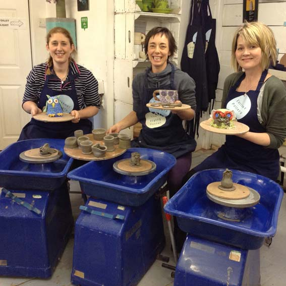Staff from Dean Close School Cheltenham learn pottery skills at Eastnor Pottery