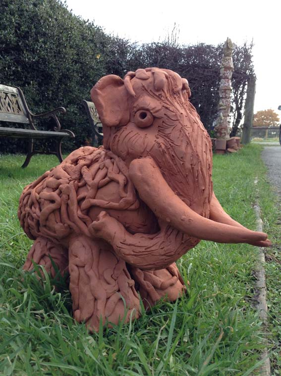 Collaborative terracotta mammoth made by families at WM&AG and Eastnor Pottery
