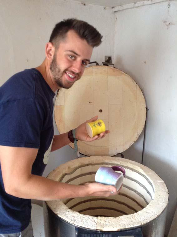 Ethan unpacking kiln at Eastnor Pottery