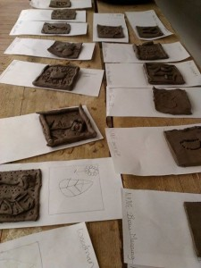 clay tiles at cheltenham science festival makershack waiting to be collected