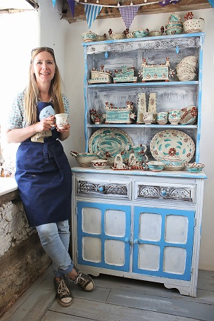 potter sarah monk standing in front of her ceramics at her studio on the eastnor castle estate