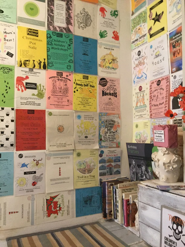 bathroom walls at eastnor pottery & the flying potter are covered in posters of past kids workshop posters from sessions in the school holidays