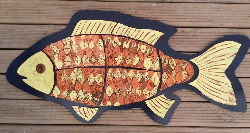 tile panel in the shape of a fish