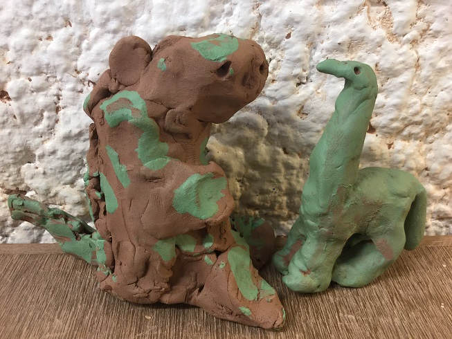 Clay dinosaurs made by YR reception at Woodlands Infant School with jon the potter from Eastnor Pottery