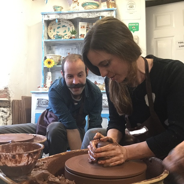 couple making pots on the potter's wheel at eastnor pottery herefordshire