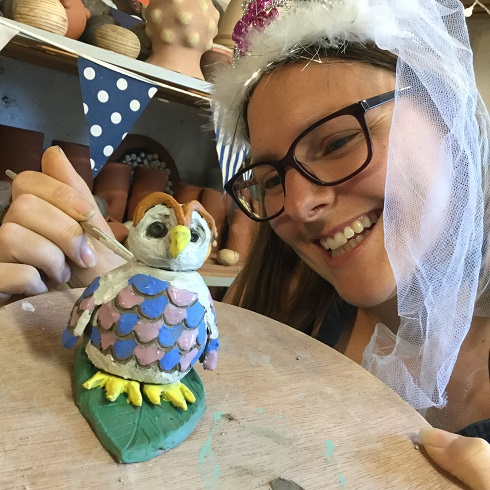bride to be making a pottery owl at her pottery hen party at eastnor pottery in herefordshire
