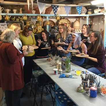 hen party group make tasteful clay sculptures at eastnor pottery in herefordshire