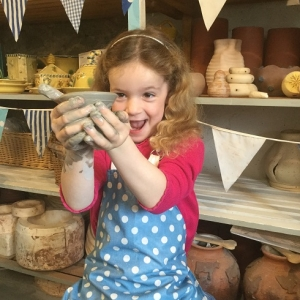 young potter proud of her pot at eastnor pottery and the flying potter taking part in hey clay 2019