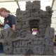 clay castle made from individual bricks made at the cheltenham science festival by lots of families and school children
