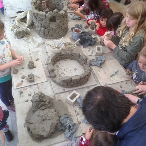 families making clay bricks in the makershack at cheltenham science festival 2019