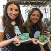 two pottery hen party participants displaying their lovely pots made at eastnor pottery