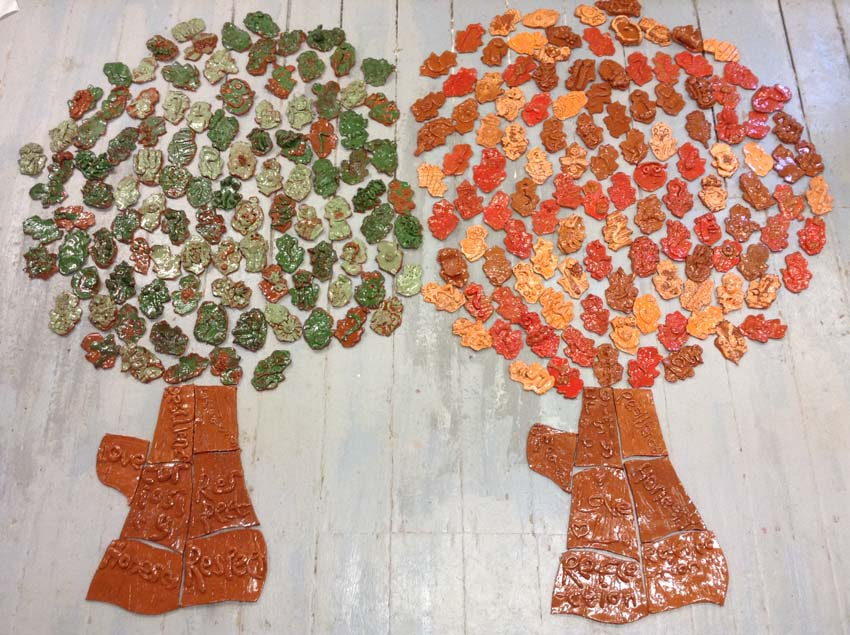 autumnal pottery leaves made by children and painted in orange and red