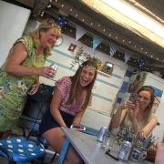 girls enjoying the potter's wheel demonstartion by jon the potter at eastnor pottery hen party