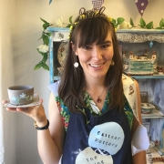 molly the hen proudly displays her pot made on the potter's wheel at eastnor pottery and the flying potter herefordshire